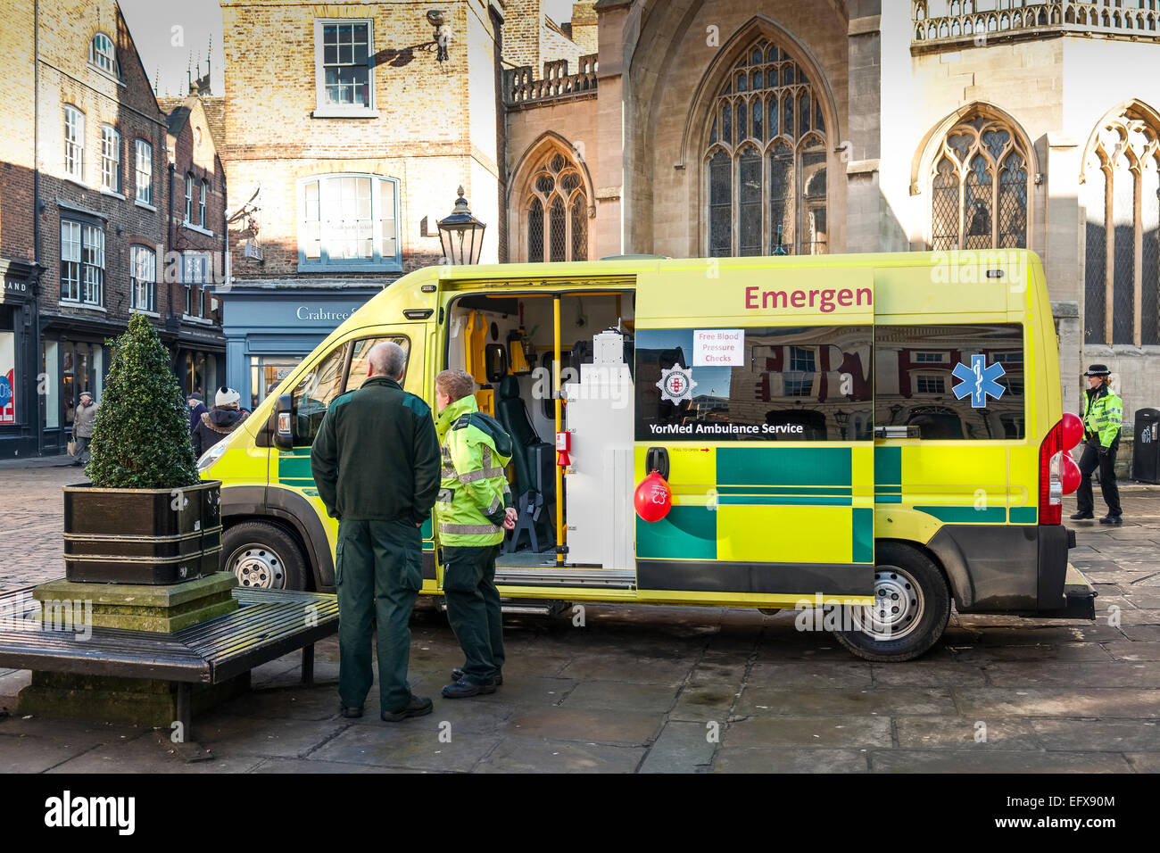 An ambulance parked in the centre of York offering a free blood pressure check service to the public a public health - Stock Image