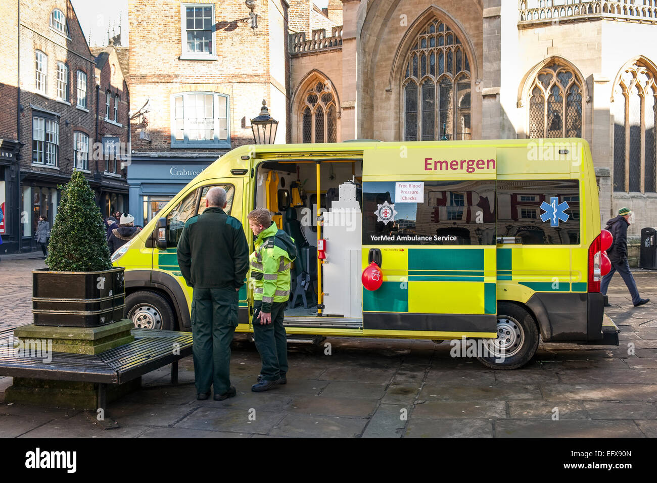 An ambulance parked in the centre of York offering a free blood pressure check to the public, members of the public. - Stock Image