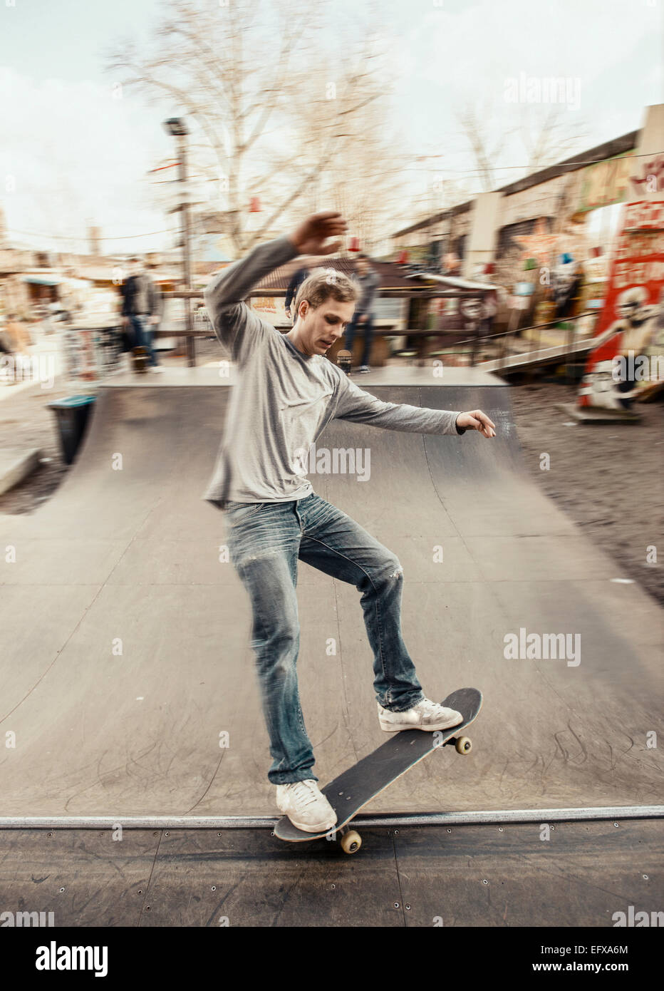 Skateboarding on mini ramp, 5-0 grind, Berlin, Germany - Stock Image