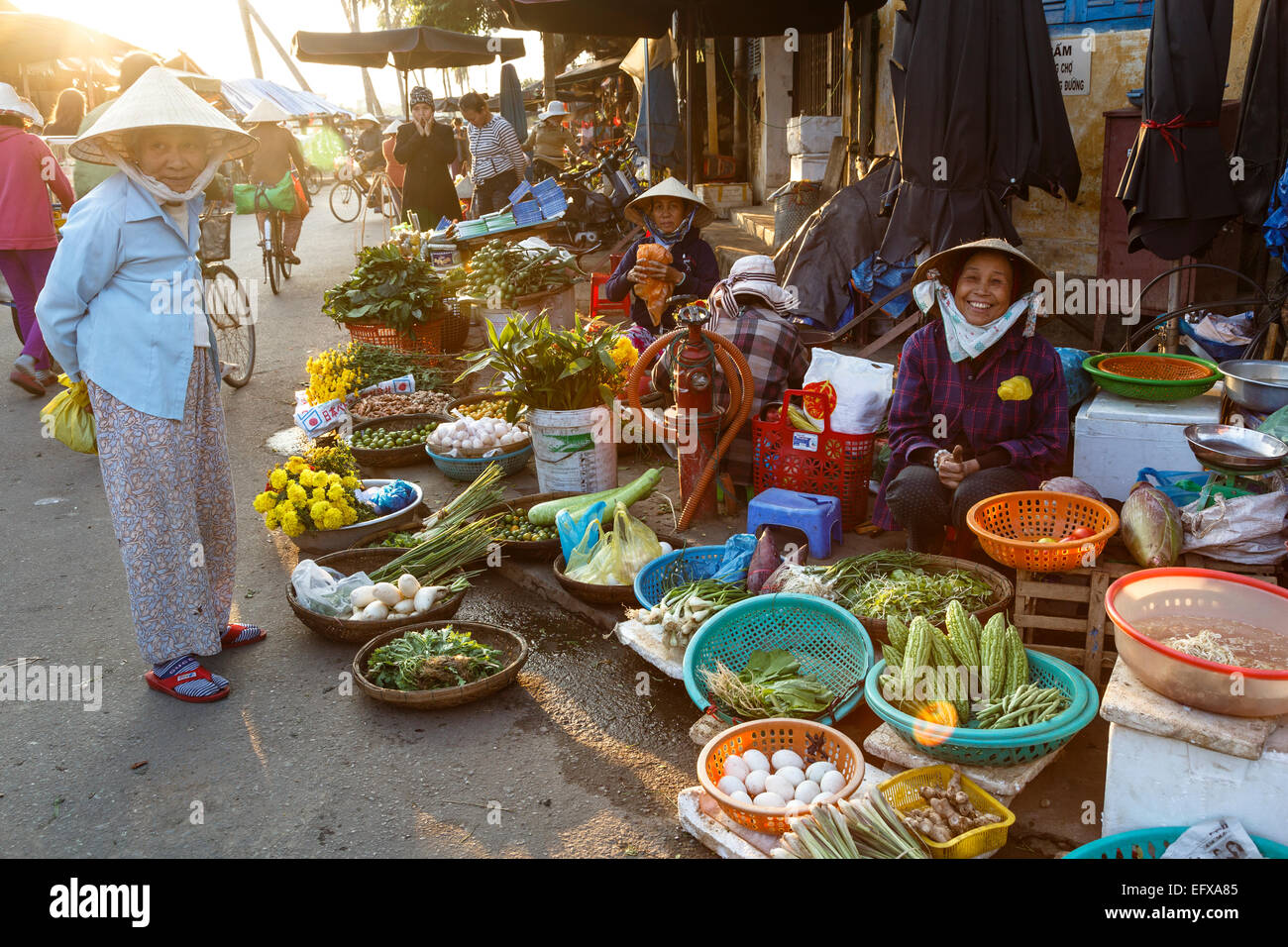 Fruits and vegetables vendors at the Central Market, Hoi An, Vietnam. - Stock Image