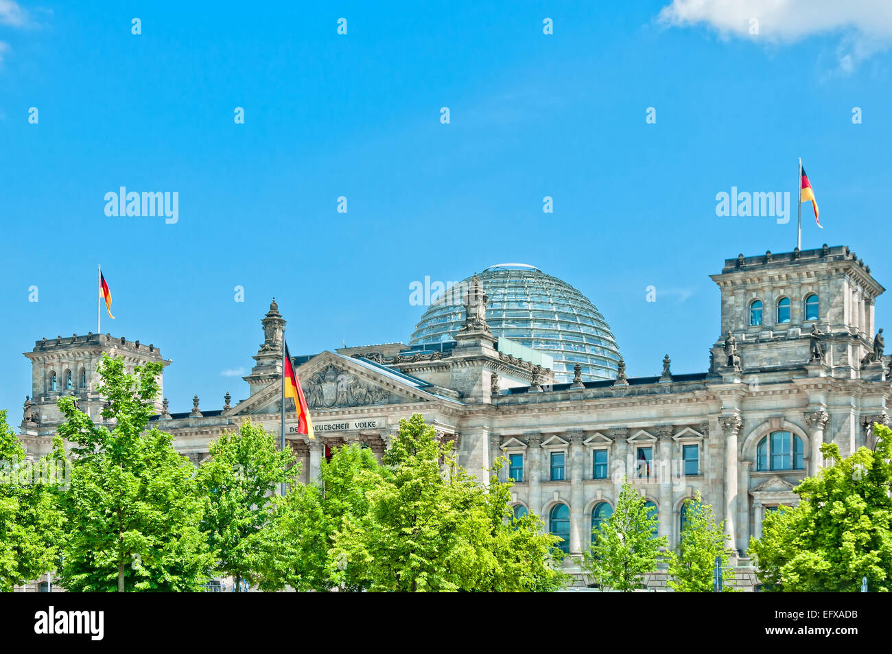 Berlin, Germany - June 8, 2013: German Parliament or Bundestag with national flag in Berlin, Germany. The building - Stock Image