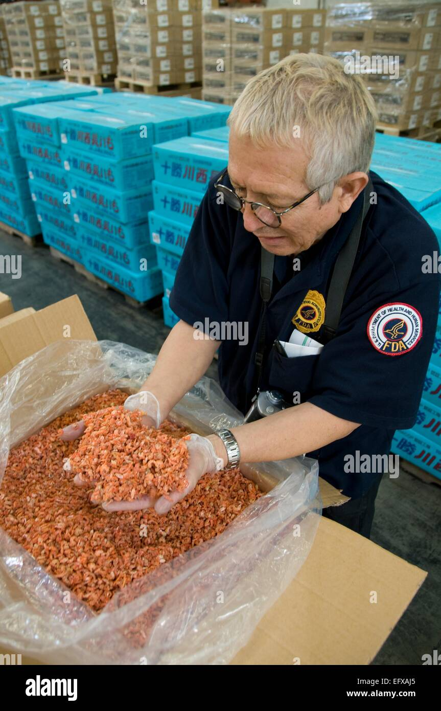 A US Food and Drug Administration field inspector checks