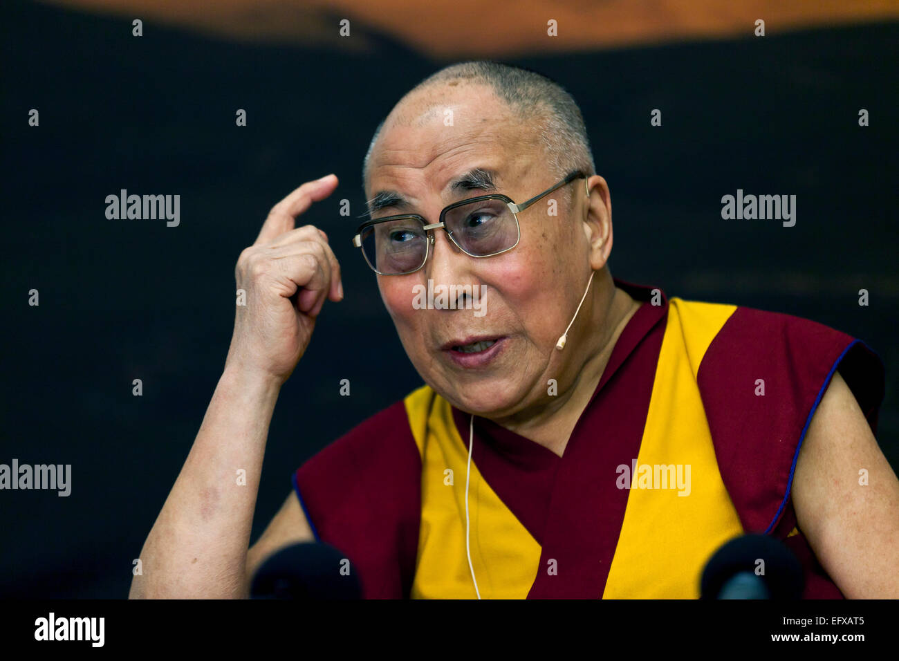 Copenhagen, Denmark. 11th February, 2015. Dalai Lama talks to the media during his press conference in Copenhagen. Stock Photo