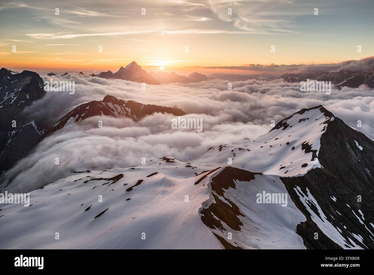 View of Bavarian Alps as sun rises above the clouds, Oberstdorf, Bavaria, Germany - Stock Image