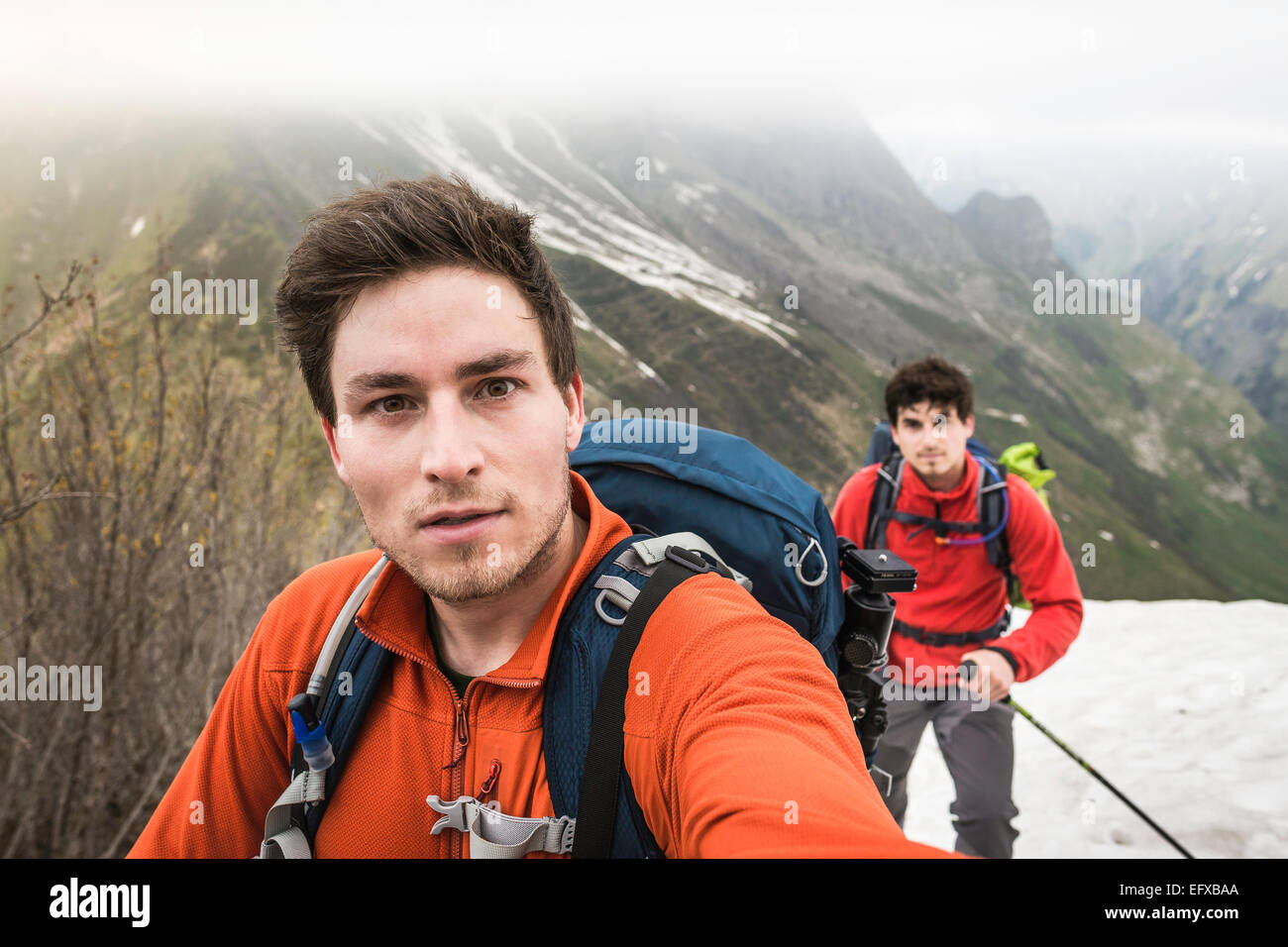 Self portrait of two brothers mountain trekking, Bavarian Alps, Oberstdorf, Bavaria, Germany - Stock Image