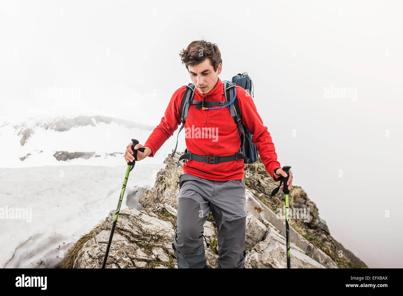 Young man trekking in Bavarian Alps, Oberstdorf, Bavaria, Germany - Stock Image