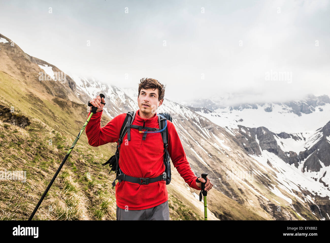 Young man mountain trekking in Bavarian Alps, Oberstdorf, Bavaria, Germany - Stock Image