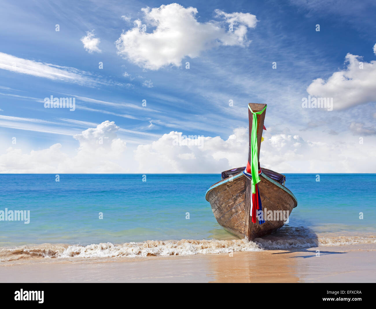 Wooden boat on pristine beach, nature background. - Stock Image