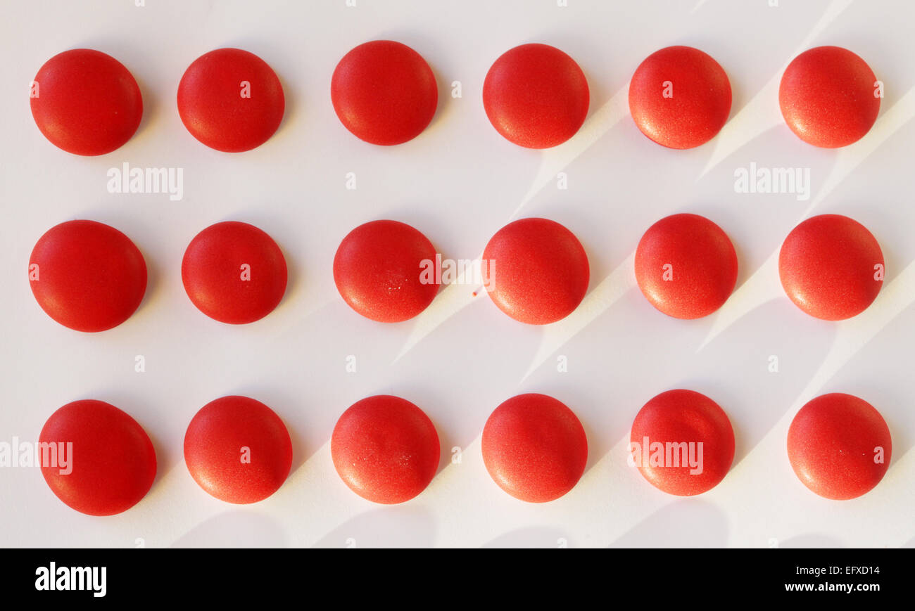 dot candies on strip of paper - Stock Image