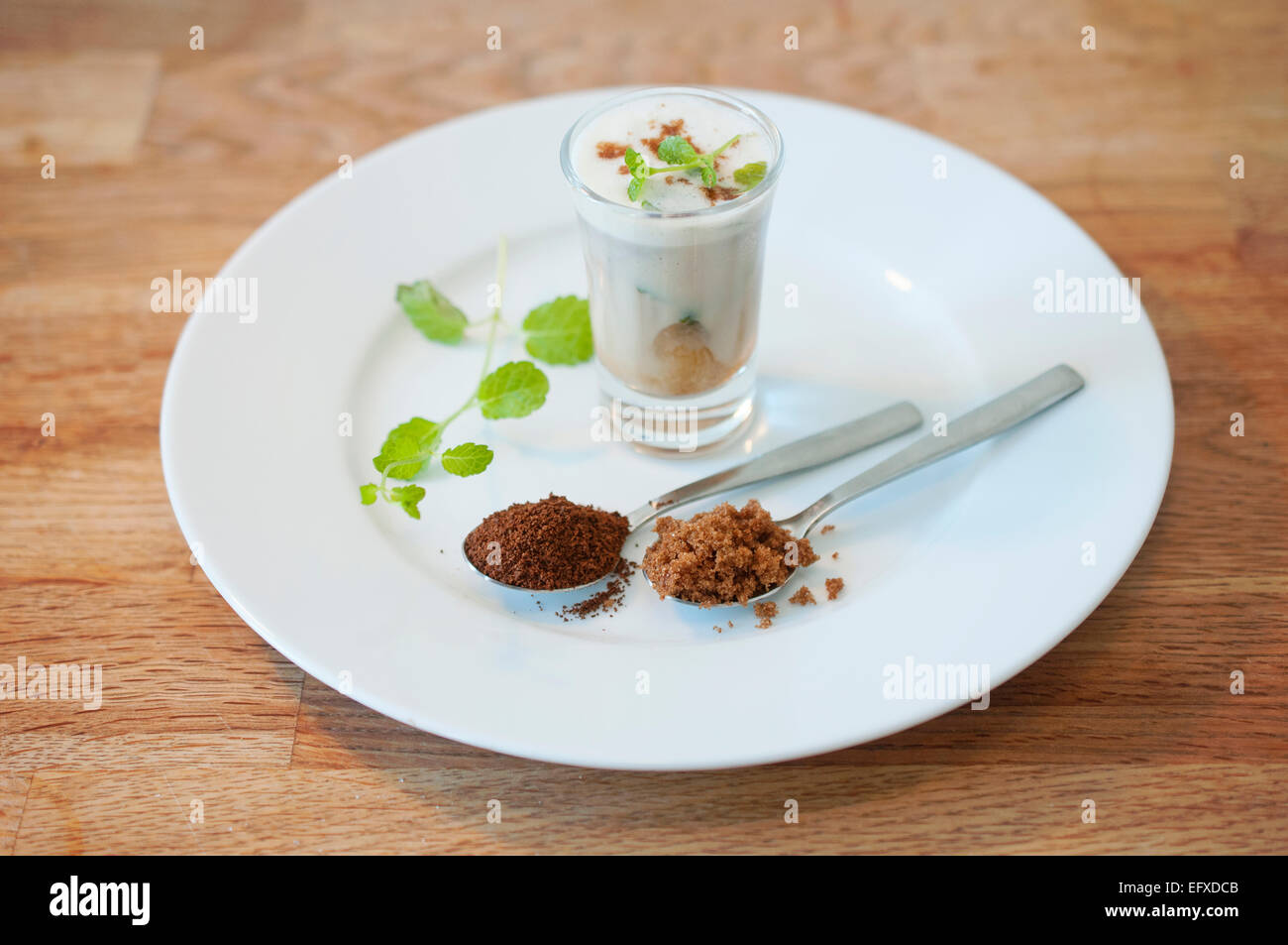 Homemade specialty coffee beverage with fresh mint, brown sugar and frothy soy milk. Serve chilled over ice or warm. - Stock Image