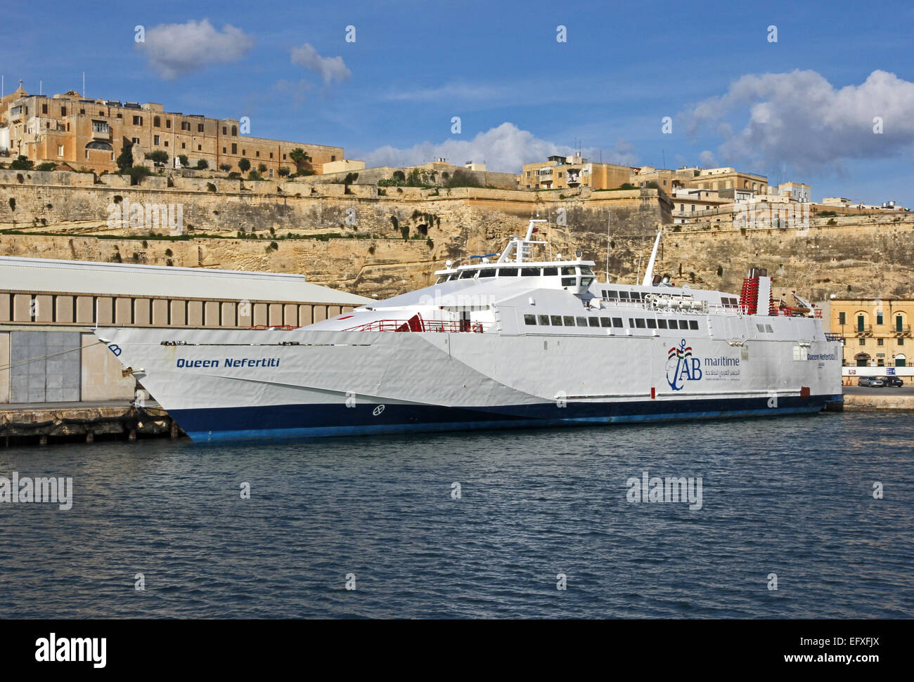 Queen Nefertiti, operated by AB Maritime, moored in Grand Harbour, Valletta, Malta - Stock Image