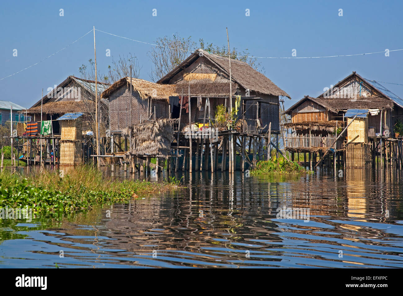 Intha lakeside village with traditional bamboo houses on stilts in Inle Lake, Nyaungshwe, Shan State, Myanmar / - Stock Image
