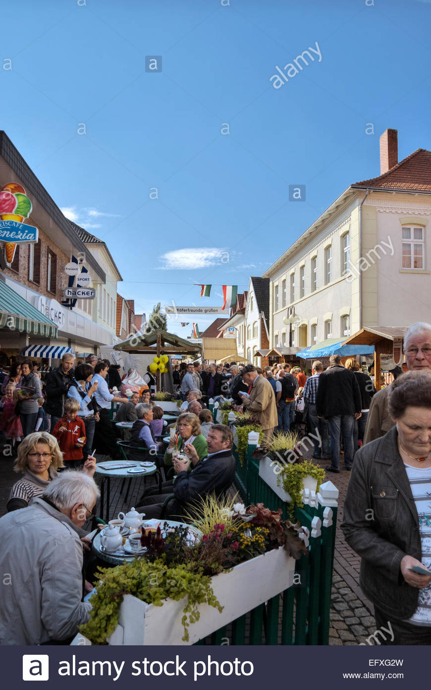 Outdoor refreshments are served on Grossestrasse in Fürstenau, Lower Saxony, during Hansetag festival. - Stock Image