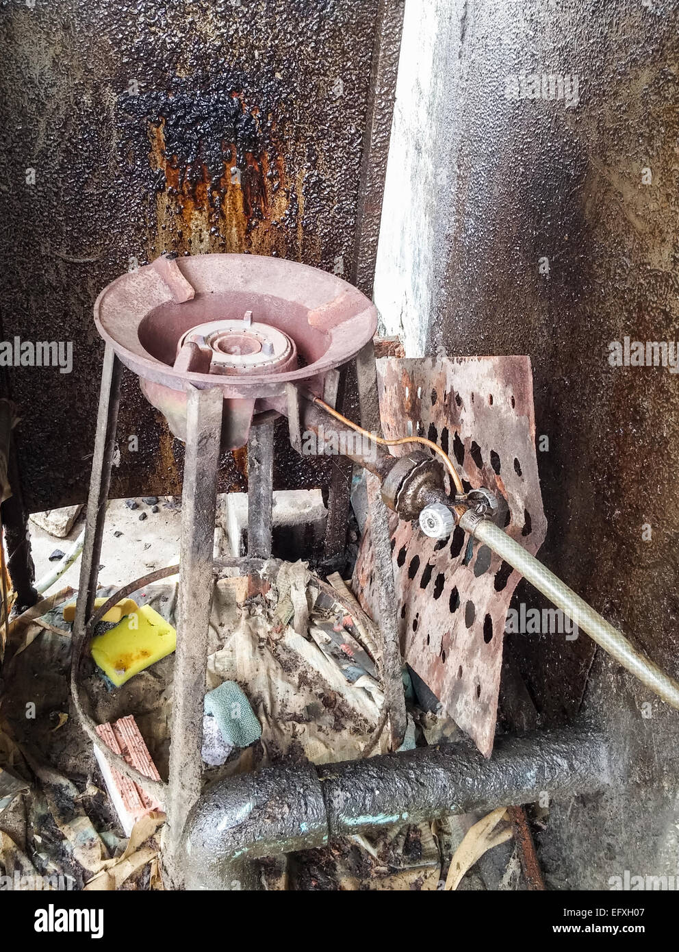 Old gas stove behind the restaurant. - Stock Image