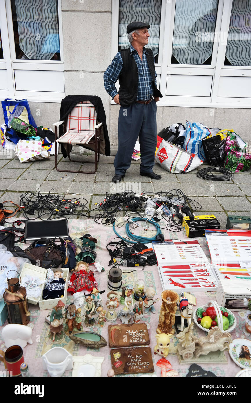 PETIT-RECHAIN, BELGIUM - JULY 2014  Seller with his wares at a Brocante, a jumble sale in Belgium - Stock Image
