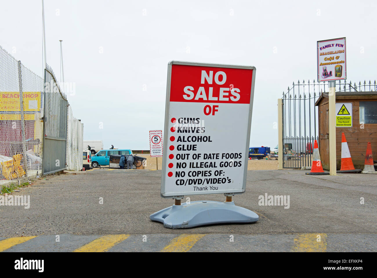 Sign outside car-boot sale: no guns, knives, alcohol, glue, out of date foods, illegal goods, copies of CDs, DVDs - Stock Image