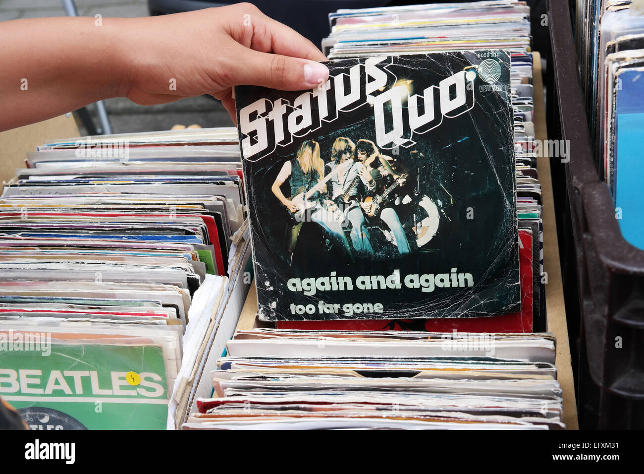 BELGIUM - JULY 2014  Single record of the English rock band Status Quo, again and again, on a flea market - Stock Image