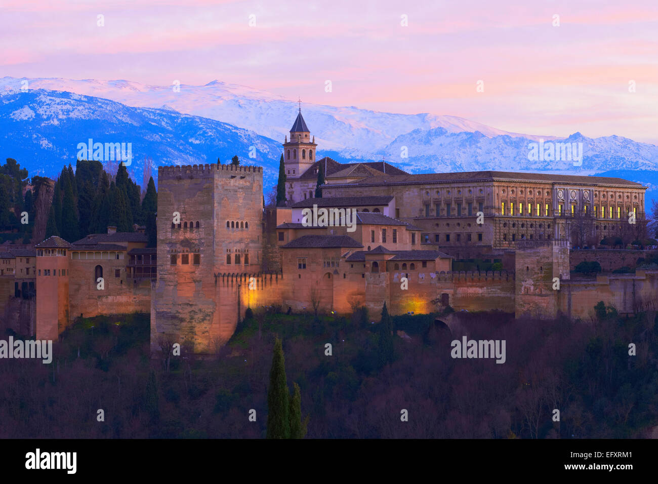 Alhambra, UNESCO World Heritage Site,Sierra Nevada and la Alhambra at Dusk, Granada, Andalusia, Spain - Stock Image