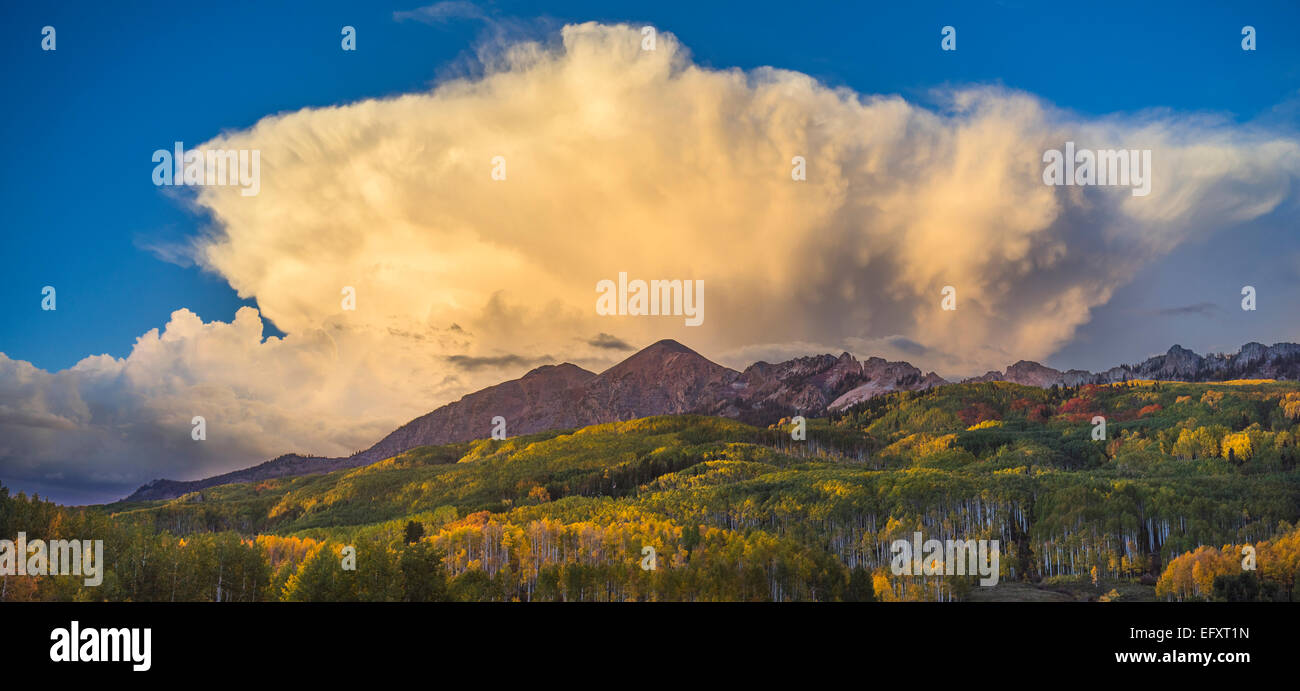 Gunnison National Forest, CO: Billowing clouds over the Ruby Range in early fall Stock Photo