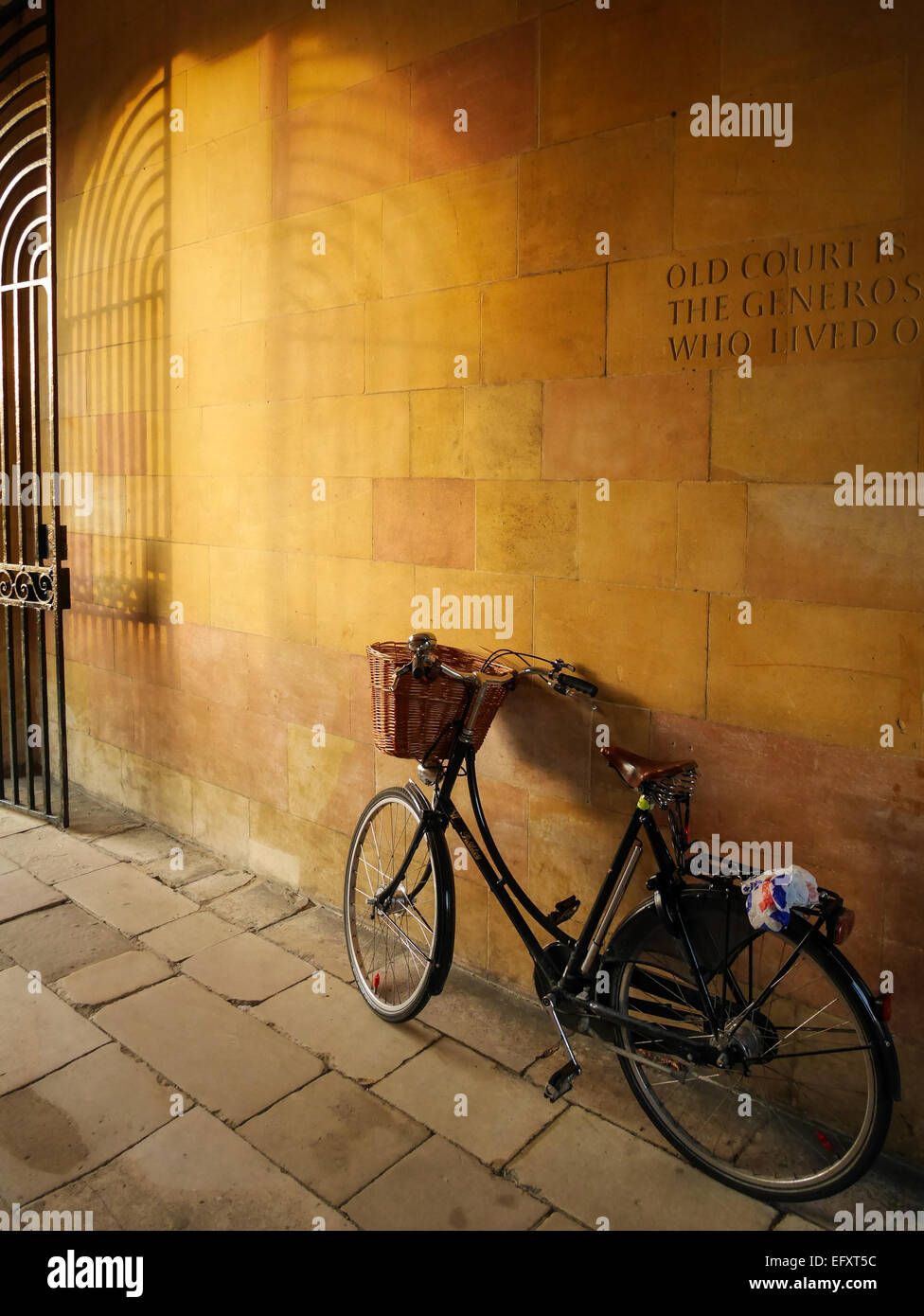 Bike leaning against a wall, University of Cambridge - Stock Image