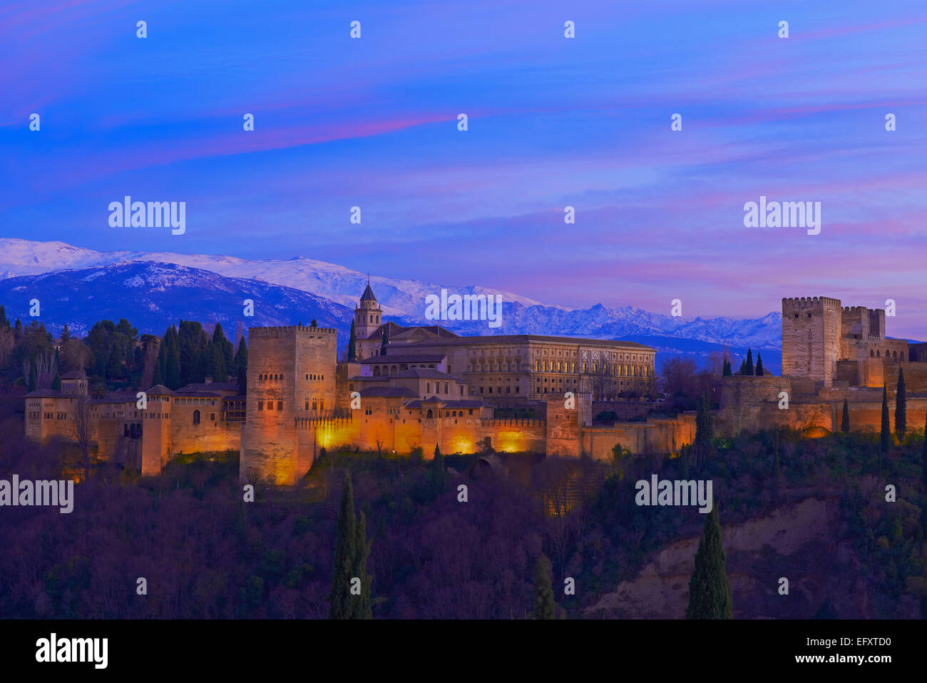 Alhambra, UNESCO World Heritage Site, Sierra Nevada and la Alhambra at Dusk, Granada, Andalusia, Spain Stock Photo