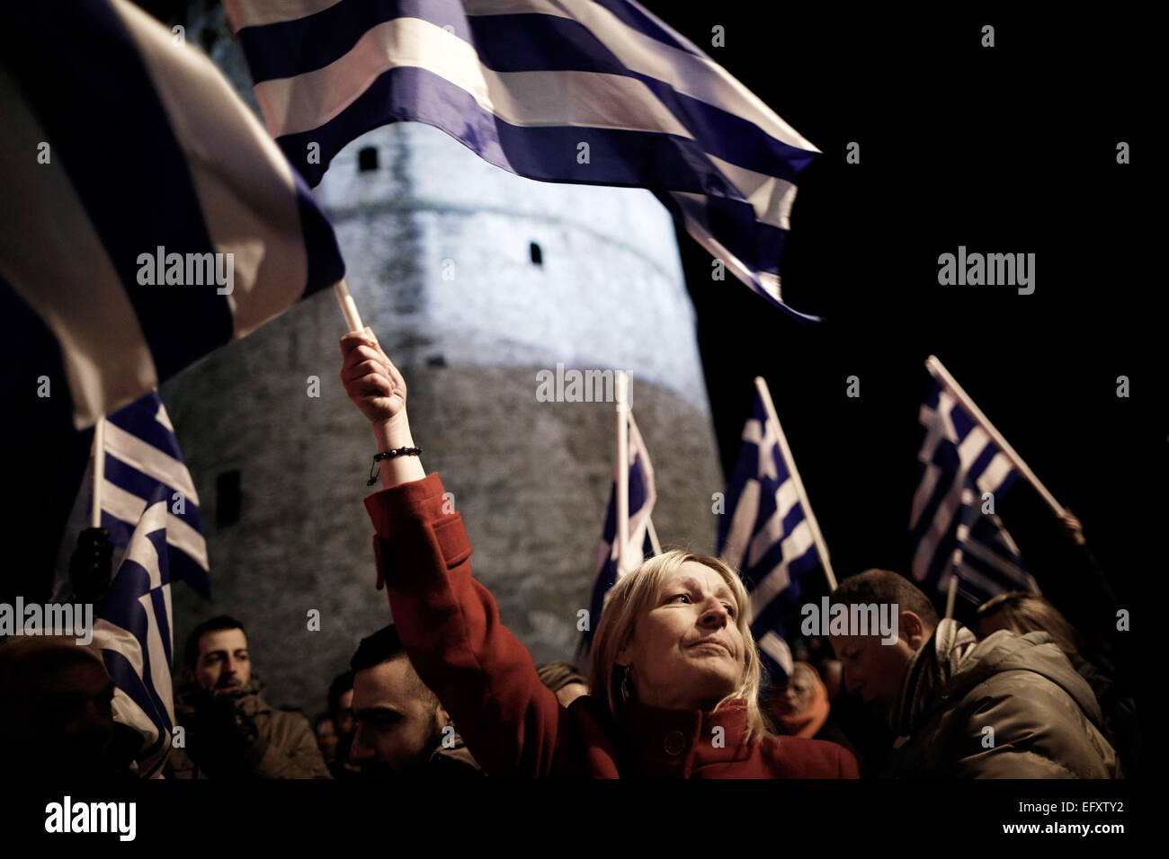 Pro-government protesters gathered in front of Thessaloniki's landmark White Tower to back its demands of a - Stock Image