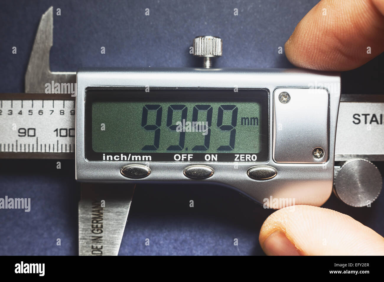Details of modern measuring tool, digital display showing precise dimension in two decimals. - Stock Image