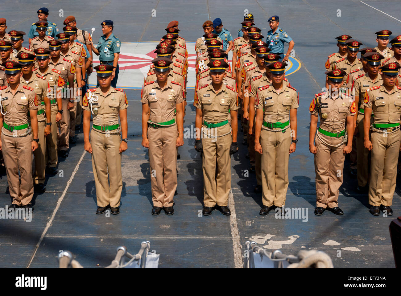 Indonesian navy cadets lining up before the last sail of the original Dewaruci tall ship in 2012. - Stock Image