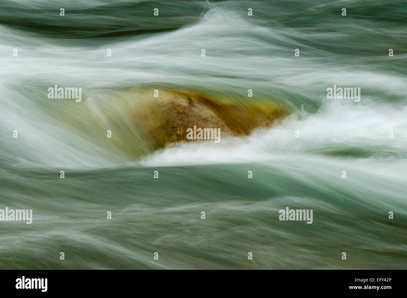 Water flowing over rock on the Middle Fork of the Salmon River in the Frank Church - River of No Return Wilderness - Stock Image