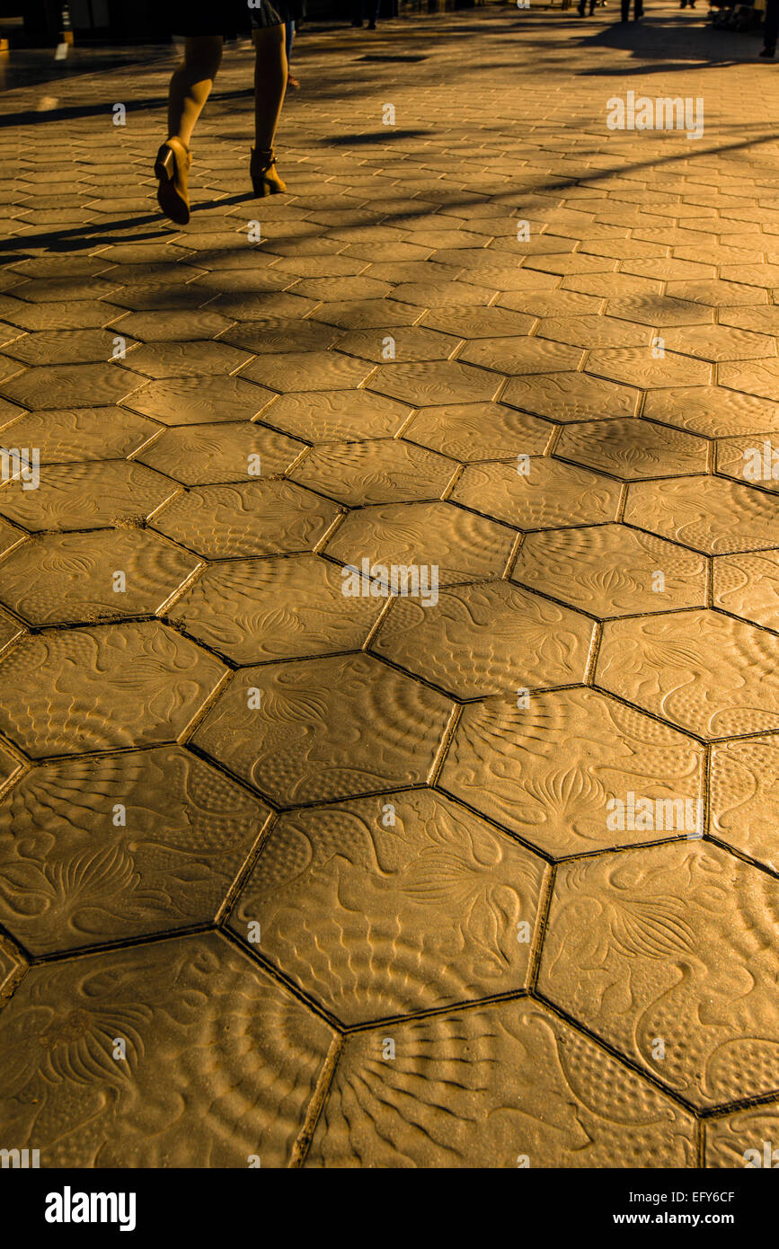 Sunset view of the tiled sidewalk in Passeig de Gracia, Barcelona, Catalonia, Spain Stock Photo