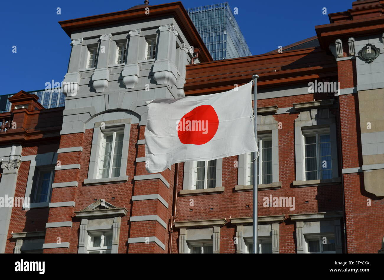 Japanese Flag in front of the Tokyo Railway Station. Stock Photo