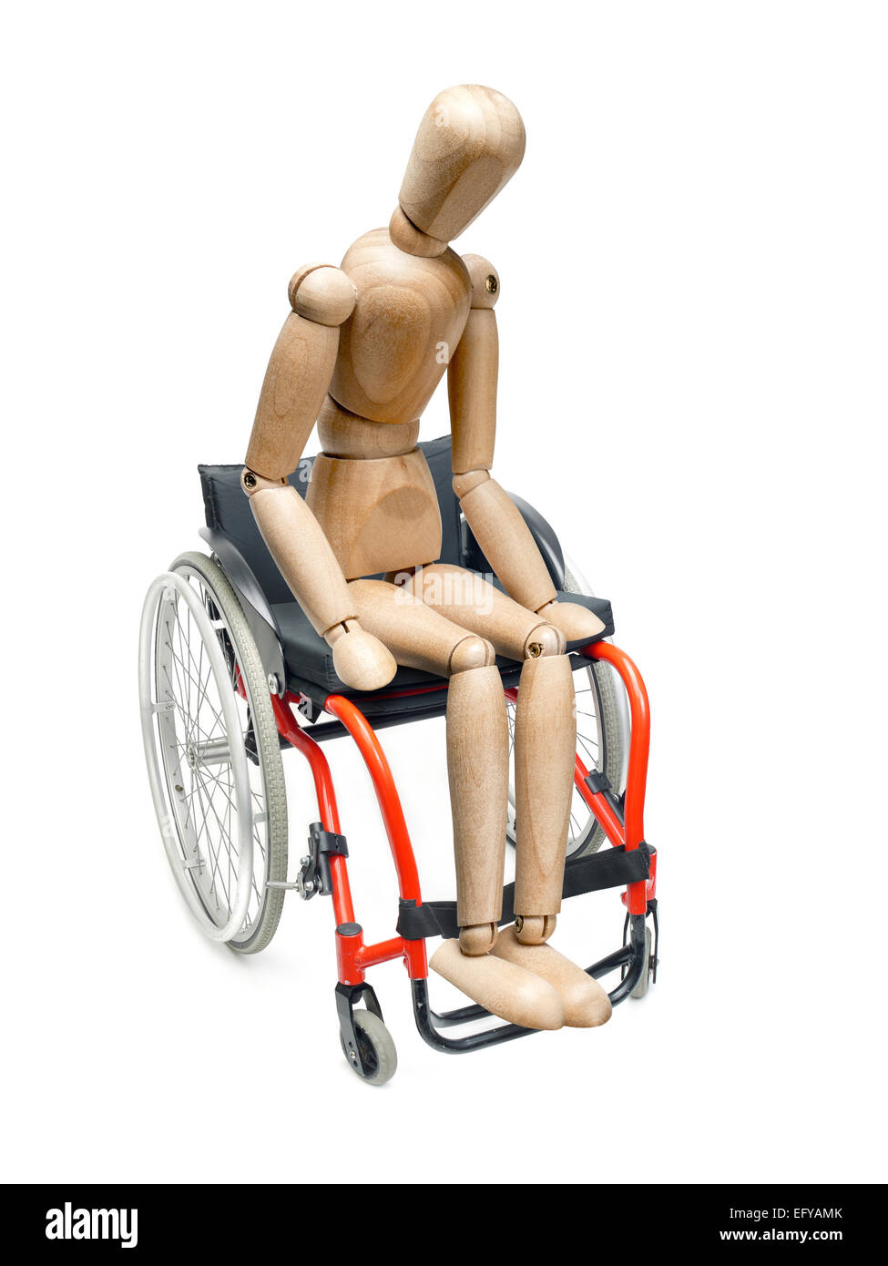 Wooden dummy sitting on wheelchair on white background - Stock Image