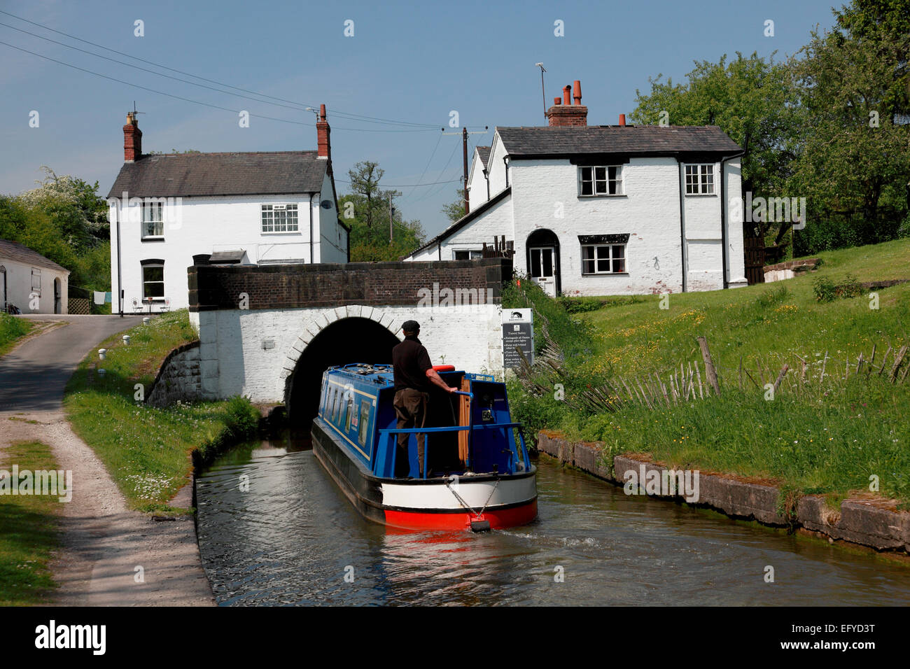 A narrowboat entering the southern portal of Preston Brook Tunnel on the Trent and Mersey canal in north Cheshire - Stock Image