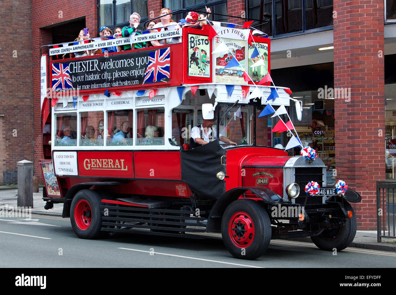Old-fashioned red, double-decker tour bus in Chester, England - Stock Image