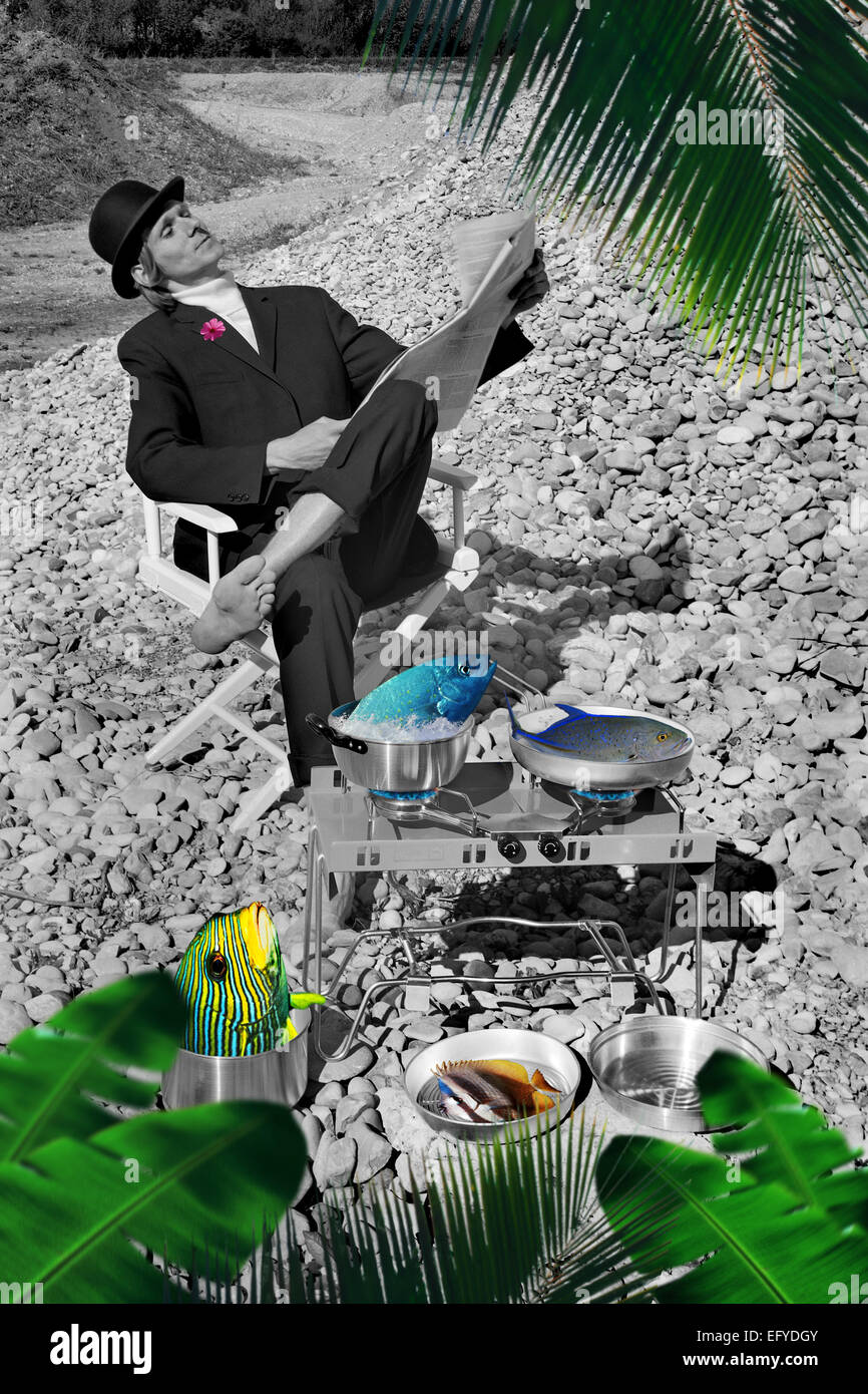 Man with bowler hat with camping equipment, fish and gas cooker, Isar, Bavaria, Germany - Stock Image
