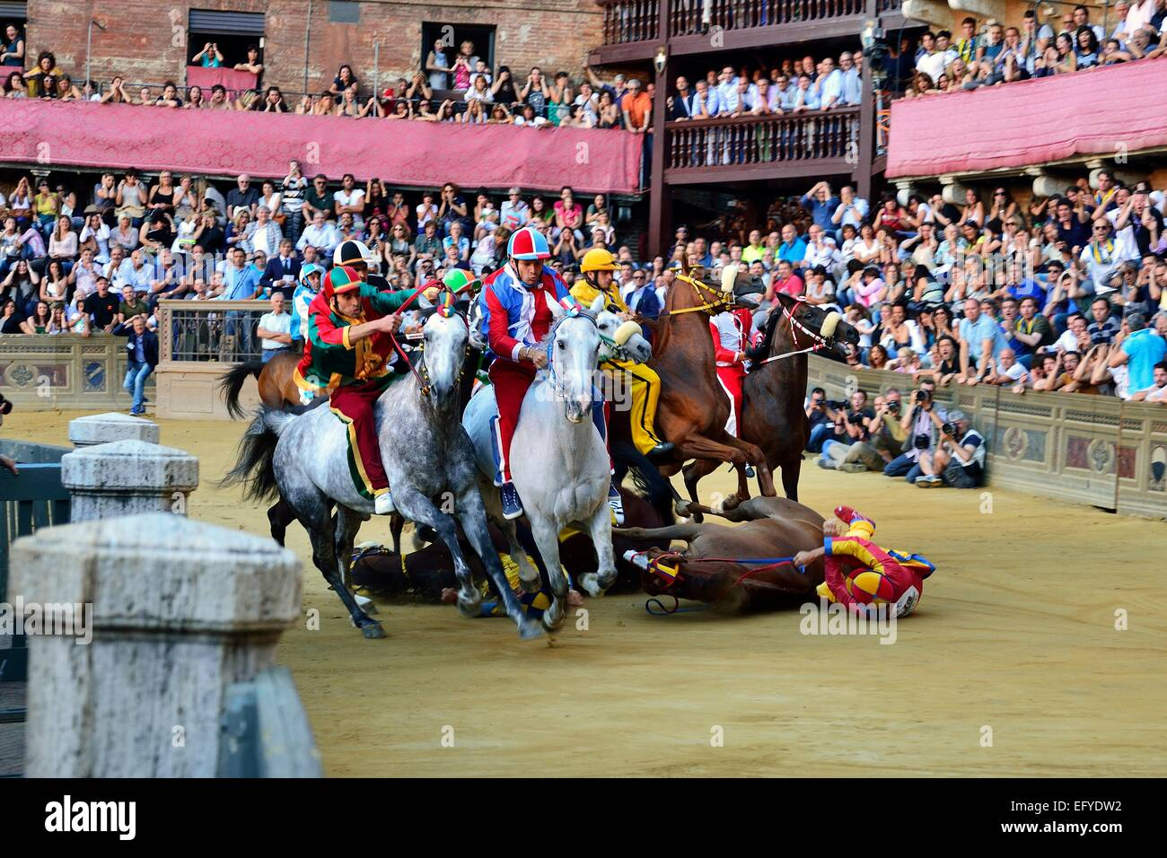 Accident during a training run of the historical horse race Palio di Siena, Piazza del Campo, Siena, Tuscany, Italy - Stock Image