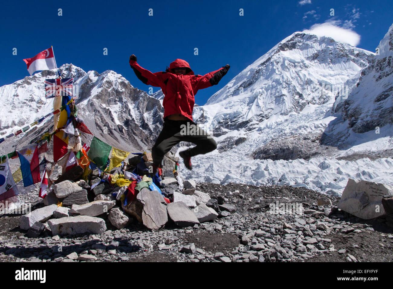 Celebrating having reached Everest Base Camp - Stock Image