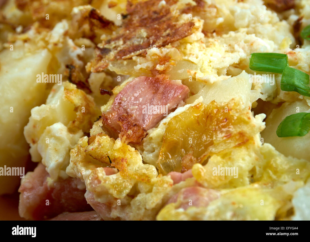 Bauernfruhstuck Farmer's breakfast. German country breakfast dish made from fried potatoes, eggs, onions, leeks Stock Photo