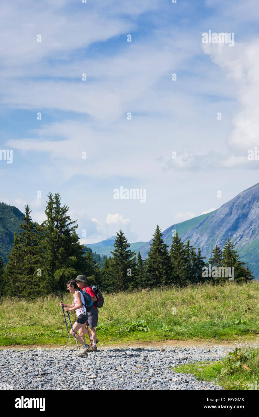 Walkers on a path above the Chamonix Valley, French Alps, France, Europe - Stock Image