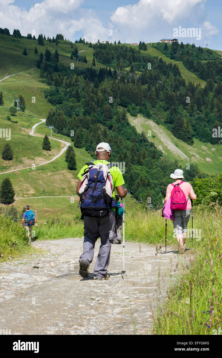 Walkers hiking in summer in the the French Alps near Prarion, Chamonix Valley, France, Europe - Stock Image