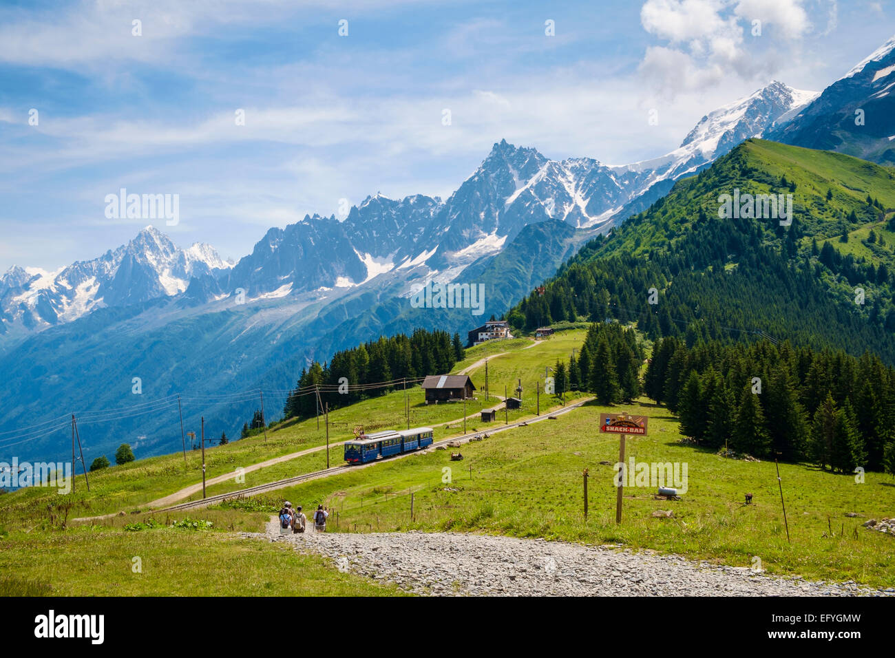 Walkers and Mont Blanc tramway cog train at Bellevue over Chamonix Valley, French Alps, France, Europe - Stock Image