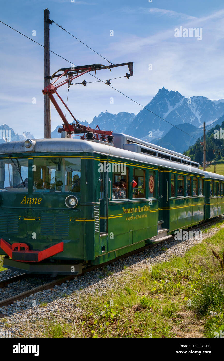 The Mont Blanc mountain cog train with the Aiguille du Midi behind, at Bellevue, near Chamonix, French Alps, France - Stock Image
