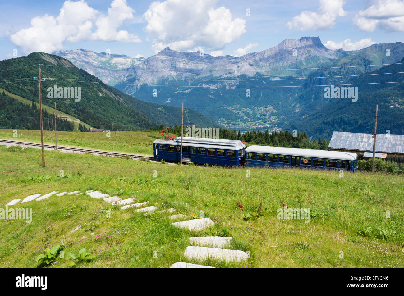 The Mont Blanc mountain cog train with Servoz village below, at Les Houches,  Bellevue, near Chamonix, French Alps, - Stock Image