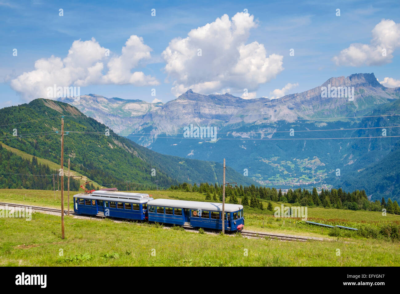 The Mont Blanc mountain cog train with Servoz village below, at Bellevue, near Chamonix, French Alps, France - Stock Image