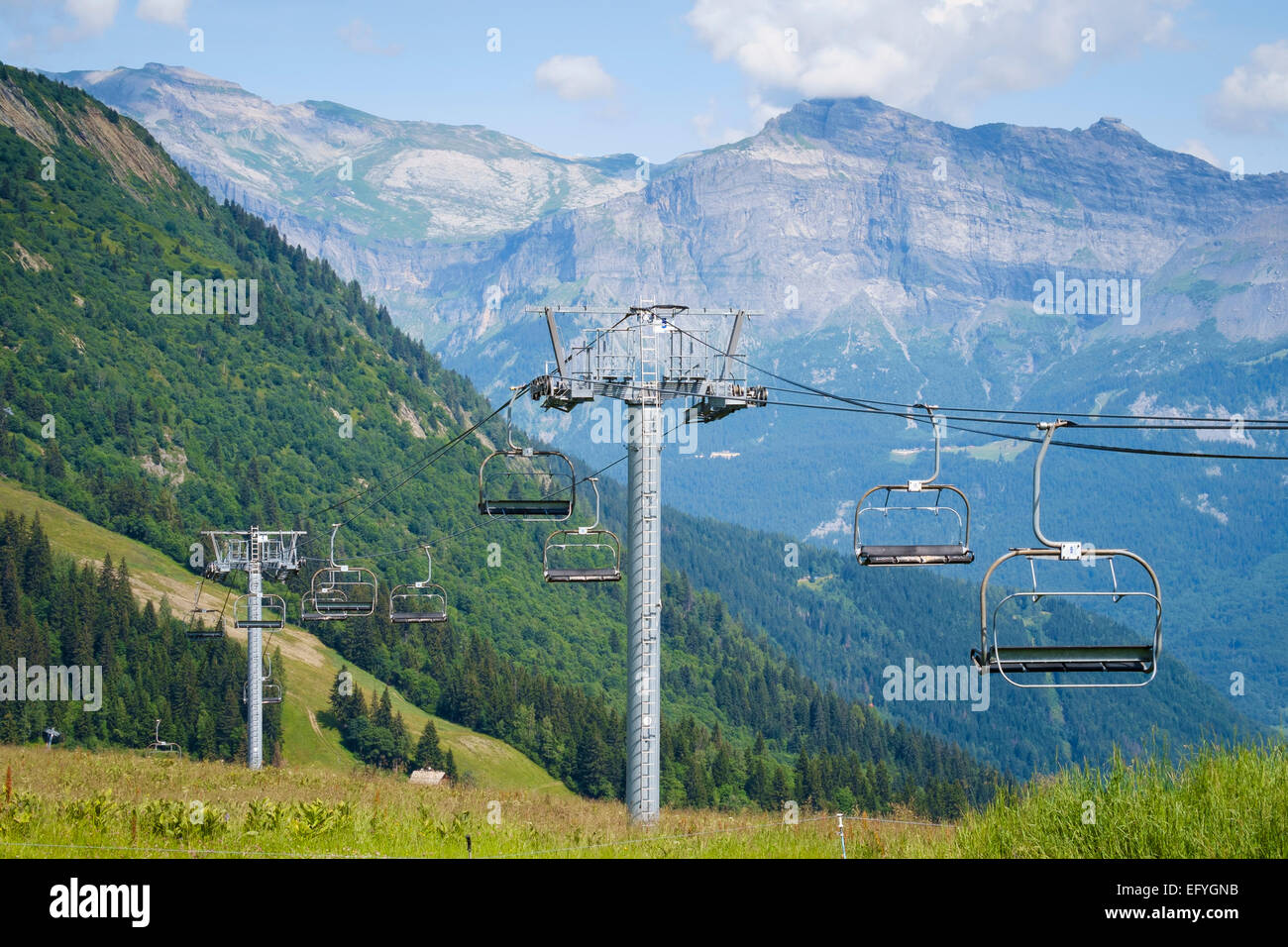 Ski lift or Chairlift overlooking the Chamonix Valley from Bellevue, French Alps, France - Stock Image