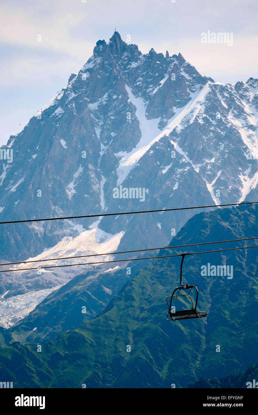 Chairlift with Aiguille du Midi mountain behind, Chamonix, French Alps, France, Europe - Stock Image