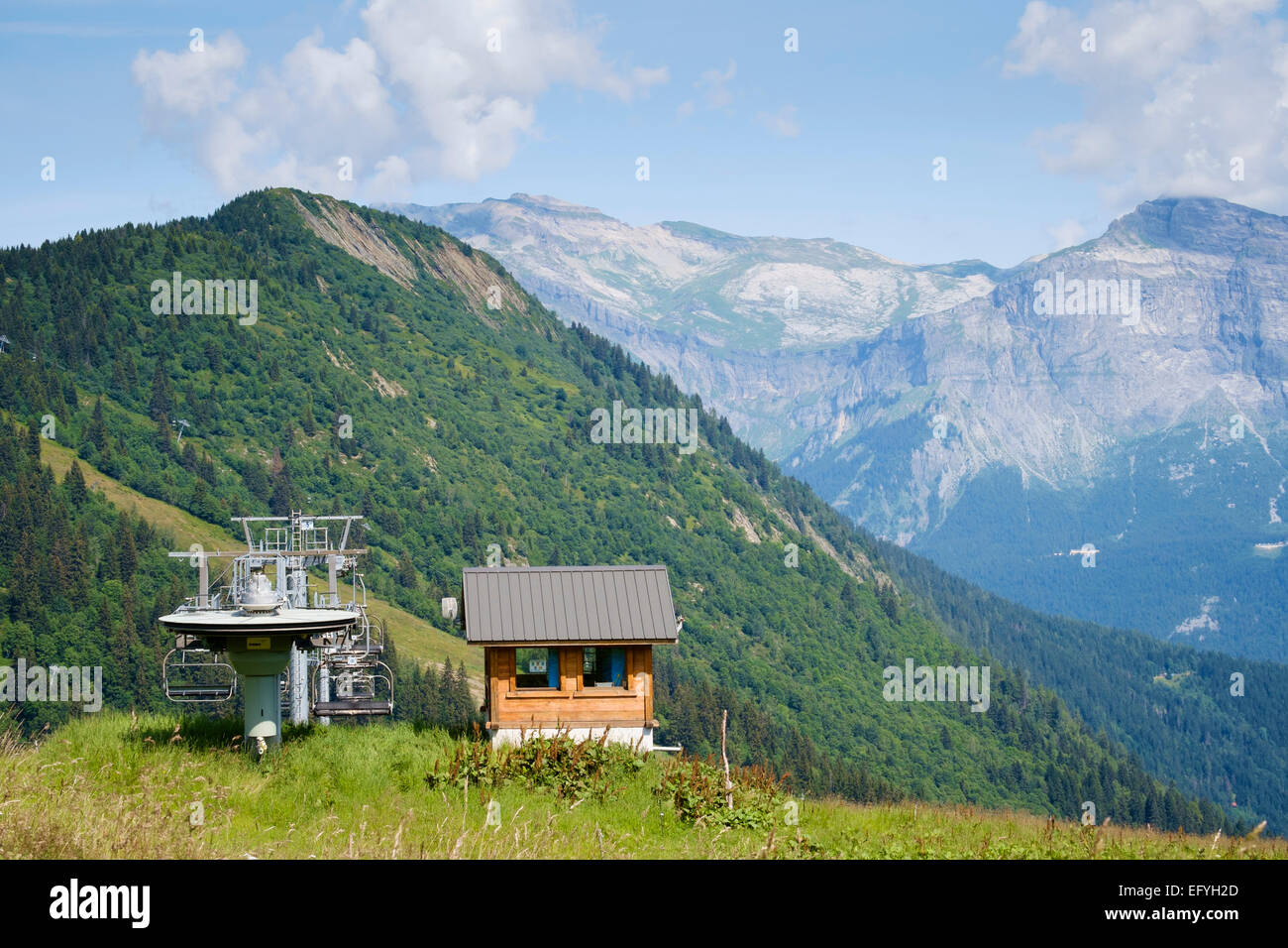 Chairlift or ski lift above the Chamonix Valley, France, Europe - Stock Image