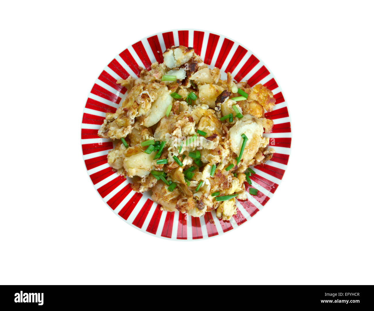 Curried Hash Brown Scramble - crispy browned potatoes tossed sauteed onions, curry powder, and scrambled eggs - Stock Image
