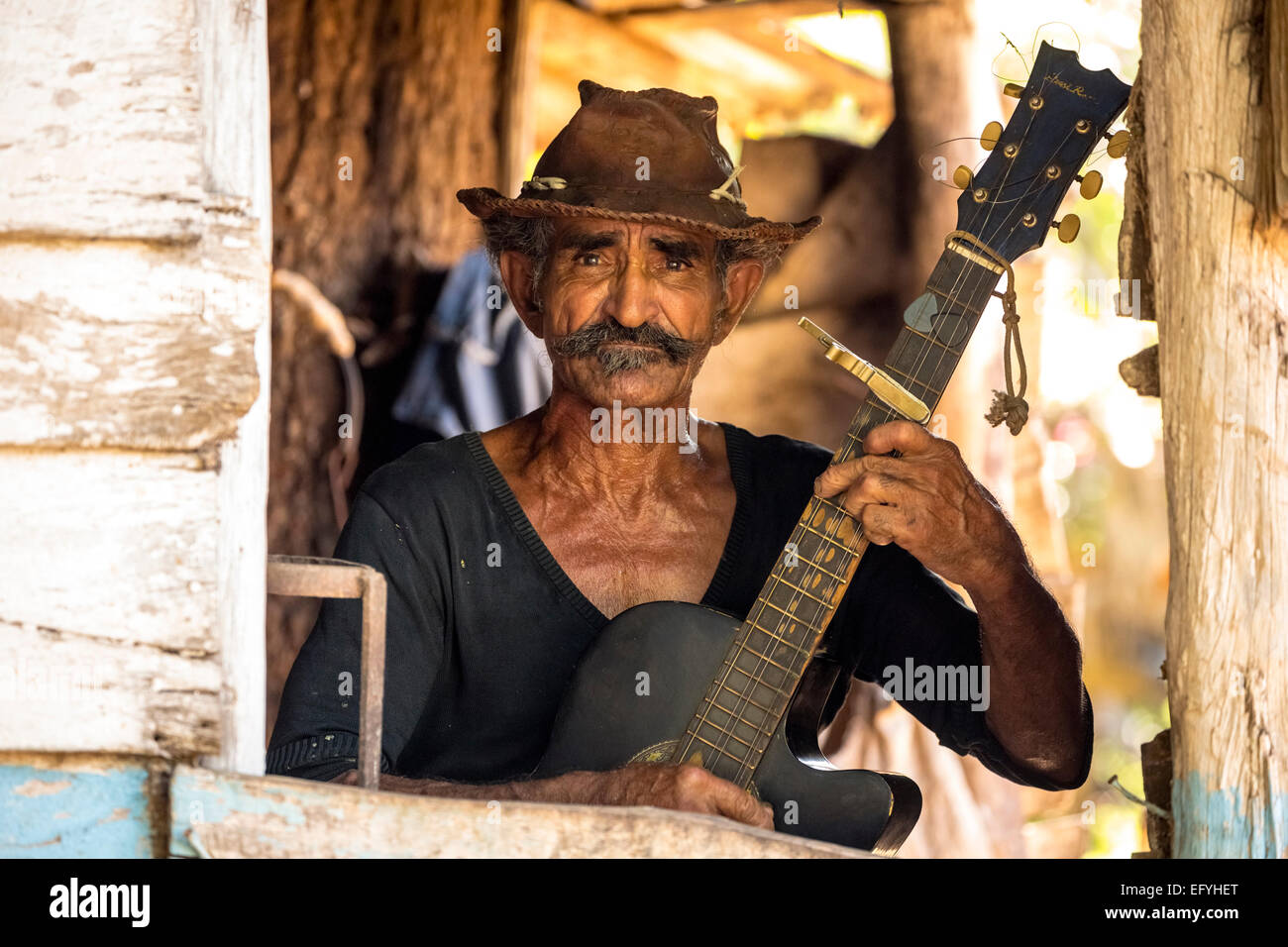 Sugar cane farmer playing the guitar, Valle de los Ingenios, Trinidad, Sancti Spiritus Province, Cuba - Stock Image