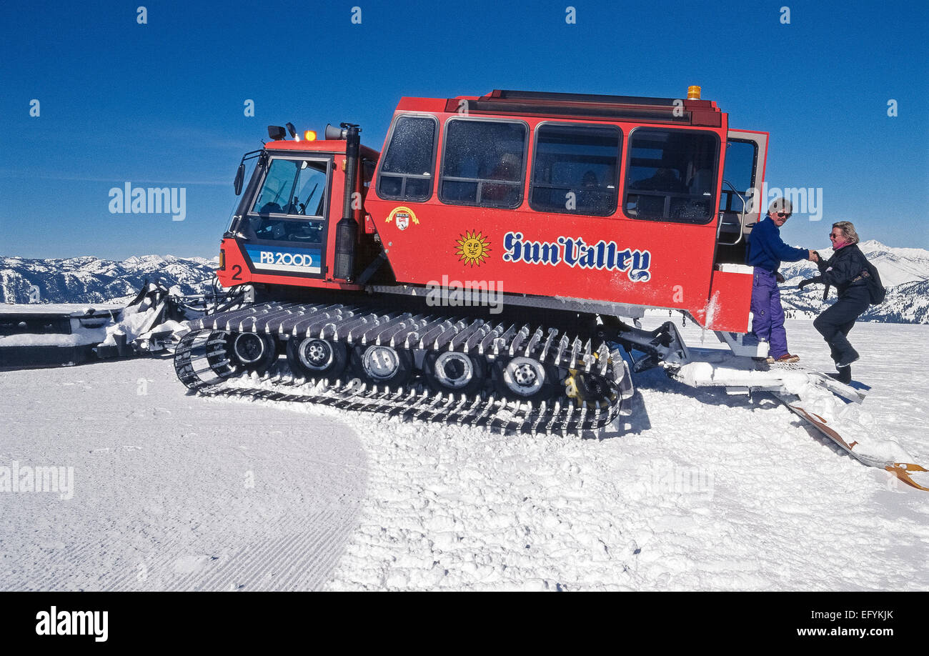 A snowcat vehicle takes visitors up snow-covered Bald Mountain for panoramic views of winter scenery at the resort Stock Photo